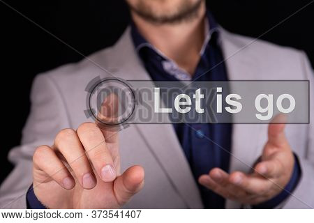 Businessman Presses A Button Finger With The Text Let Is Go. Business Concept.