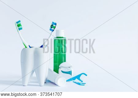 Oral Hygiene Products And Model Of Tooth On White Background. Dental Care Concept.