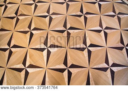Background Of Parquet Various Wood Species, The Geometric Pattern Triangles Rays. Backgrounds Struct