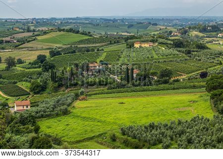Beautiful View Of The Geen Tuscany Hills During A Summer Morning.