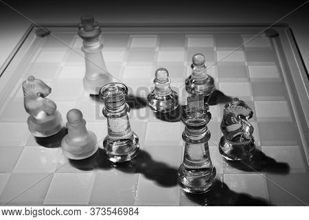 International Chess Day Concept. Glass Chess With Shadows On Checkerboard