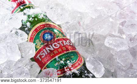 Two Bottles Of Tsingtao Beer In Crushed Ice
