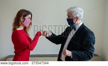 A Mature Gray-haired Man In A Suit And A Red-haired Middle-aged Woman In A Red Dress Is Wearing Mask