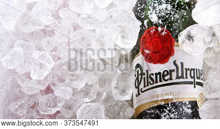 Bottles Of Pilsner Urquell Beer In Crushed Ice