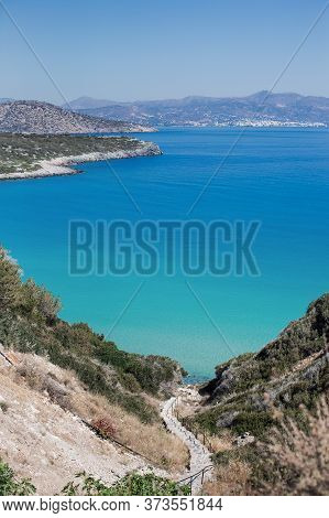 Staircase Descent From Mountain In Blue Sea. Mountain Landscape. An Island In Mediterranean.