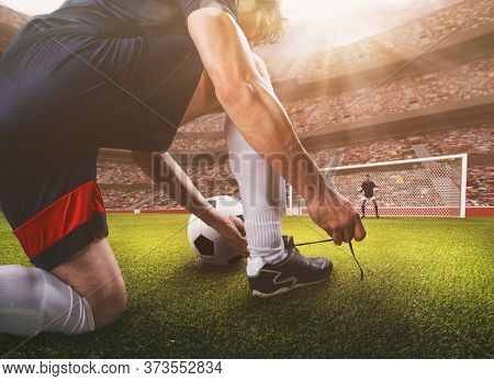 Close Up Perspective Of A Soccer Scene Match With Player Preparing To Take The Penalty Kick