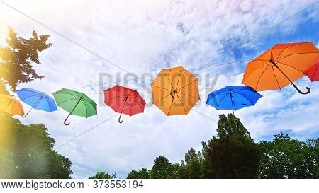 Colorful Umbrellas Background. Bright Multicolored Umbrellas In The Sky. Street Decoration With Para