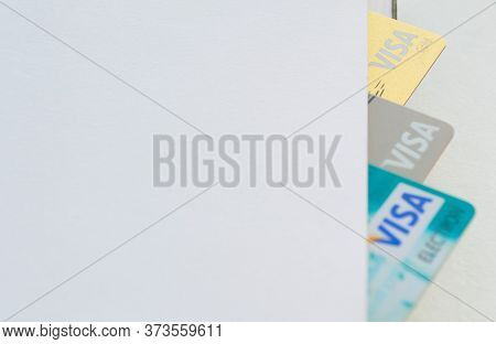 Moscow, Russia, August 2019: Credit Cards: Visa, Visa Gold, Visa Electron Look Out From A Notebook W