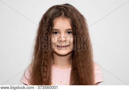 Cute Girl Without Front Tooth With Wavy Blond Hair