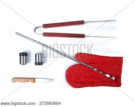 Bbq Instruments Kit (spitter, Tongs, Glove, Knife. Peper And Salt Shakers) Close Up Isolated On Whit