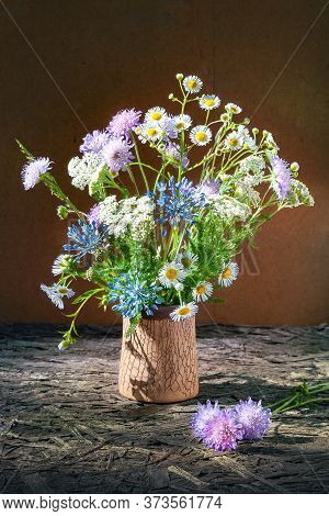 Bouquet Of Small Wildflowers In A Vase. Rustic Still Life With Wildflowers And Clover. Selective Sof