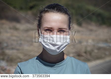 Sick Ill Young Woman, Sweaty Girl With Fever, Tempurature In Medical Protective Mask On Her Face Fee