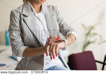 Close Up Beautiful Woman In Striped Jacket With Hand Watch At Wo