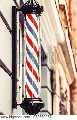 Barber Shop Pole. Logo Of The Barbershop, Symbol. Barbershop Pole, Retro. Old Fashioned Vintage Barb