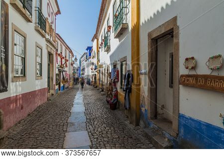 Obidos, Portugal - October 12, 2017: Tourists In A Narrow Street In Obidos Village, Portugal
