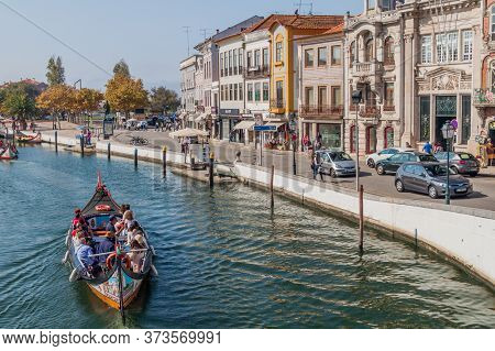 Aveiro, Portugal - October 14, 2017: Canal With Traditional Colorful Moliceiro Boats In Aveiro, Port