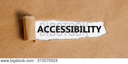 Accessibility Text Is Written On The Background Of A Businessman. Business Concept.torn Paper With O