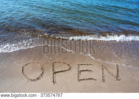 Word Open Is Written In The Sand On The Beach For The Tourists, After The Coronavirus Pandemic, Sea