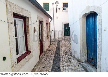 Narrow Alleys In Alfama Neighborhood Of Lisbon, Portugal