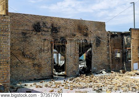 Protest And Riots In The Us Burns Violent Of A Burnt By Fire Building