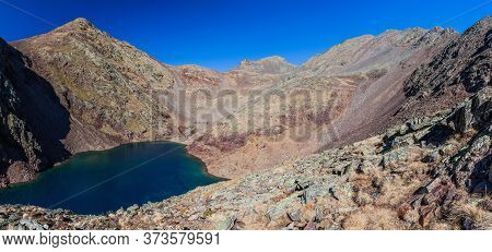 Estany Negre Black Lake In Parc Natural Comunal De Les Valls Del Comapedrosa National Park In Andorr