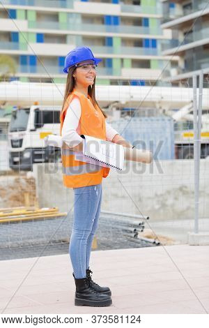 Smiling Architecture Student Standing Outside A Construction Site