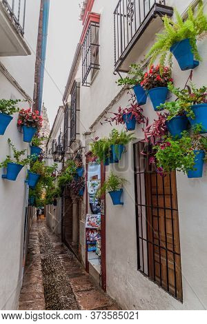 Cordoba, Spain - November 4, 2017: Narrow Street Calleja De Las Flores In Cordoba, Spain
