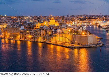Night View Of Town Senglea In Malta
