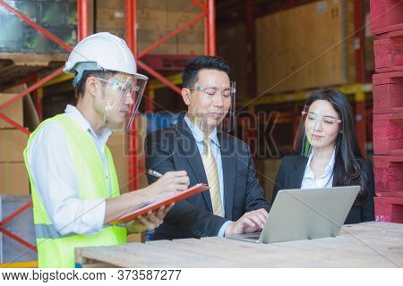 Asian Warehouse Man Managers With Beautiful Secretary And Young Chief Engineer Worker Talking And Wo
