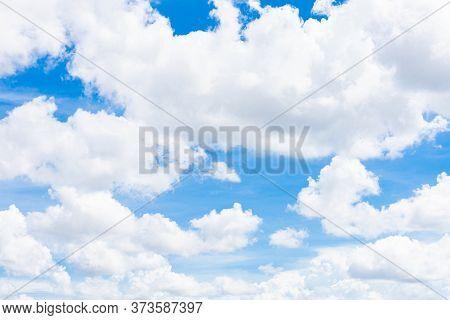 Bright Blue Sky With White Cumulus Clouds