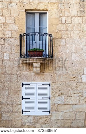 Window Of A Stone House In The Fortified City Mdina In The Northern Region Of Malta