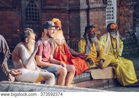 Kathmandu, Nepal : October-18-2018 : European Tourist Taken Photo With A Group Of Sadhus (yogi Or Ho
