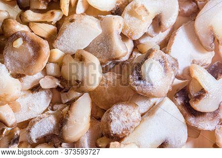 Frozen Sliced Mushrooms, Champignons On The Table. Vegetarian Food.