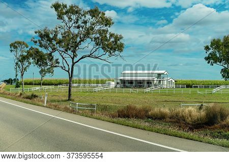 A Country Barn Shape White Homestead With Horse Paddocks