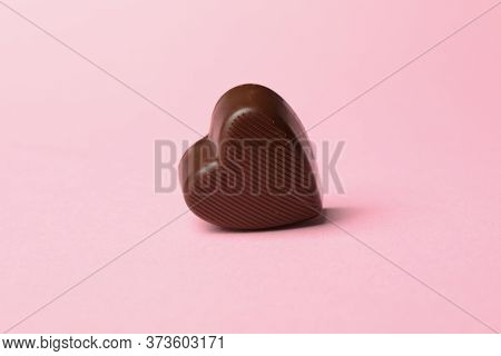 Chocolate Candy In The Heart Form On Pink Background