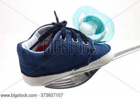 Clothing Shoe And Pacifier Of A Newborn Baby