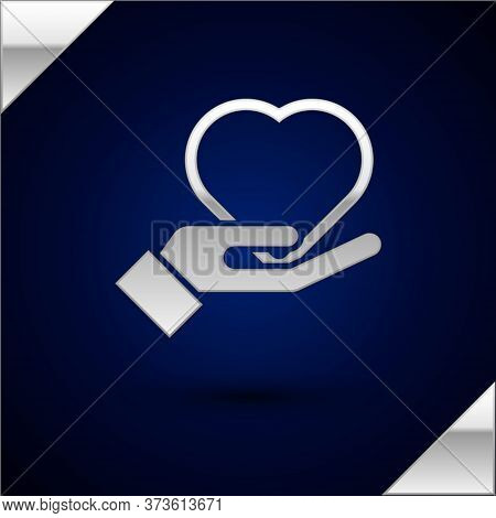 Silver Heart On Hand Icon Isolated On Dark Blue Background. Hand Giving Love Symbol. Valentines Day