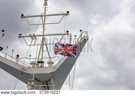 Great Britain's Flag Waving In The Wind On The Ship's Mast.