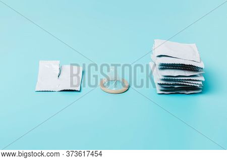 Condom On A Blue Background. The Concept Of Safe Sex, Stopping The Transmission Of Sexually Transmit