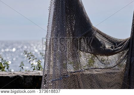 Fishing Nets Hang To Dry In The Sun, Still Lifes And Objects. Fishermen, Fishing Net