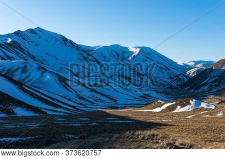 Winter Mountains Landscape With Snow-capped Mountains And Valley. Winter Nature Background