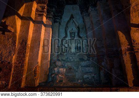 Old Buddha Statue In Wat Chai Wattanaram Temple In Ayutthaya Historical Park In Thailand