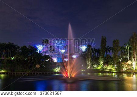 Singapore, Singapore - December 22, 2015: Gardens By The Bay Singapore Landmark At Night With Illumi