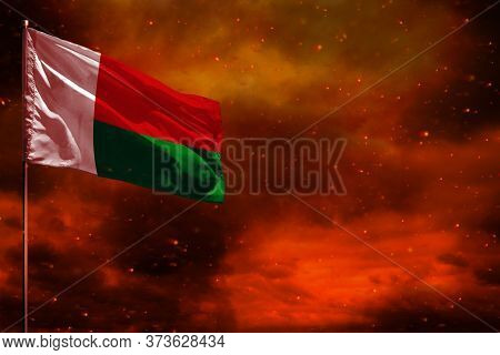 Fluttering Madagascar Flag Mockup With Blank Space For Your Data On Crimson Red Sky With Smoke Pilla