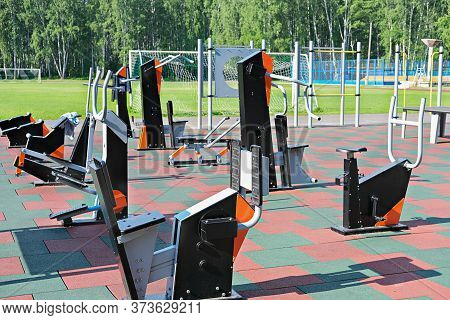 Outdoors Fitness Equipment. Sport Stadium Or Athletic Ground. Empty Training Center Outdoors. No Peo