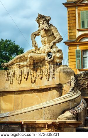 Seehof Palace, Aquarius Sculpture Against The Backdrop Of The Castle, Blurred Background. Bavaria, G