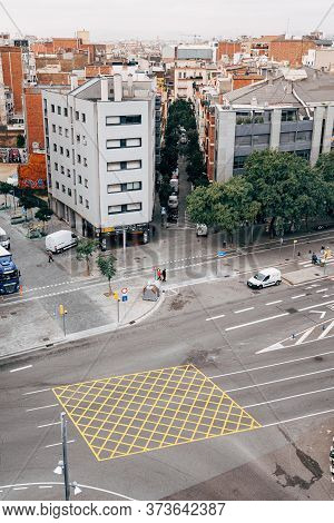 Barcelona, Spain - 15 December 2019: Yellow Road Marking - A Grid With Diagonal Lines And Marked Bor