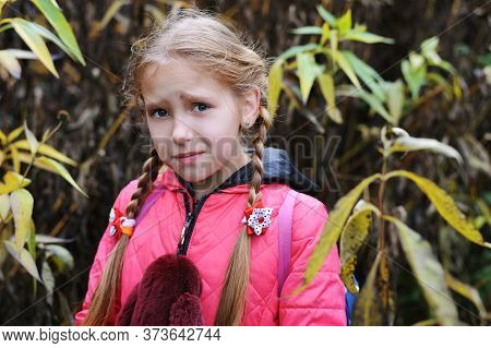 The Young Girl Got Lost In The Woods And Has A Frightened Face