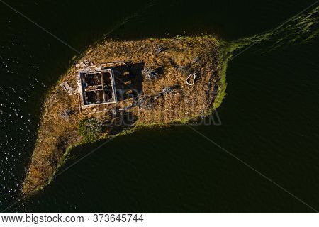 Small Island With Abandoned Old House In The Swamp Of Alcantara. Extremadura. Spain.