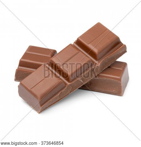 Bar of milk chocolate and pieces close up isolated on white background